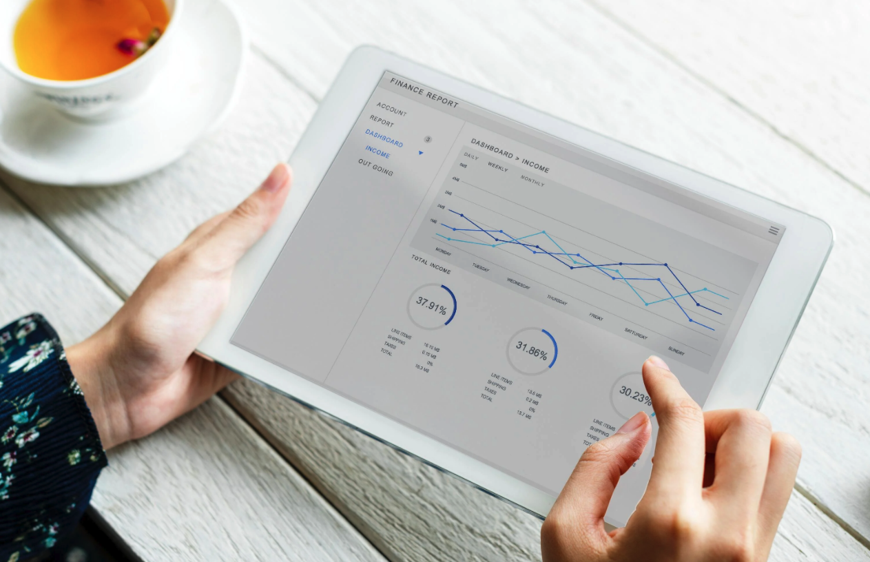 tablet with financial statistics line chart