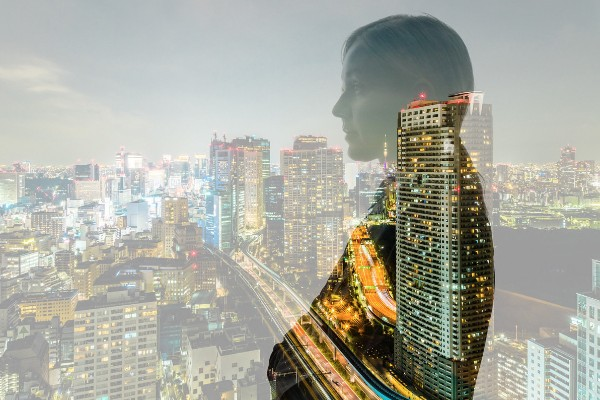 faded city background with faded woman silhouette in foreground