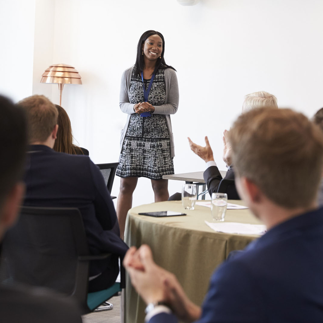 Diverse group of executives meeting in conference room